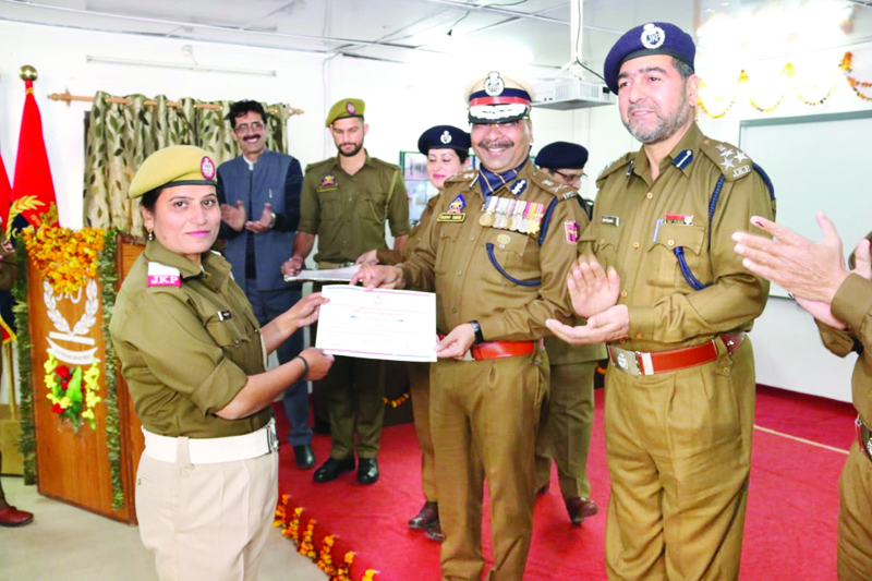 DG Prisons Dilbag Singh presenting certificate to a pass out at Jammu on Sunday.