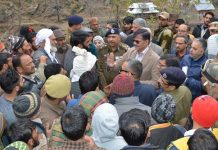 Advisor K Vijay Kumar interacting with people in Mandi on Sunday.