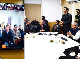 Governor interacting with students through video conferencing during e-inauguration ceremony of ICT Labs and CAL Centres on Tuesday.