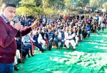 Senior Cong leader, Sham Lal Sharma addressing public meeting at Godhan in Akhnoor on Tuesday.