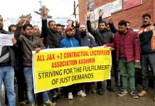 Contractual lecturers protesting in Srinagar on Thursday. -Excelsior/Shakeel