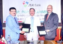 Officers of J&K Bank and BPCL exchanging copies of MoU on Monday.