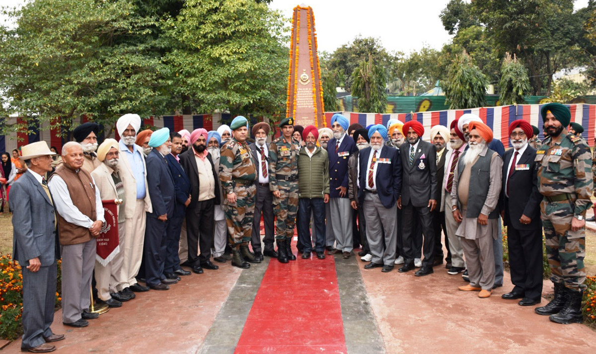 Army officers, ex-servicemen and others posing for photograph after paying tributes to war heroes at Pannu War Memorial Akhnoor on Wednesday.