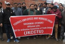 Fisheries Department employees protesting in Srinagar. — Excelsior/Shakeel