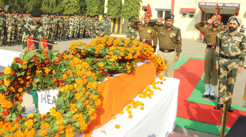 BSF officers paying tributes to martyr at BSF Headquarters, Paloura on Friday. —Excelsior/Rakesh