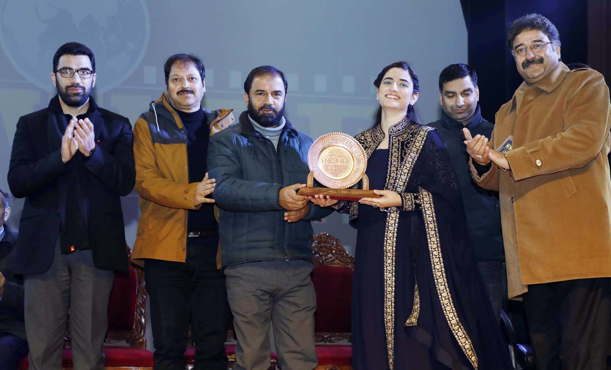 Dignitaries awarding a winner during the closing ceremony of Kashmir World Film Festival at Srinagar on Tuesday.