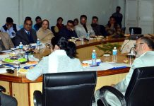 Advisor to Governor, Khurshid Ahmad Ganai chairing a meeting at Jammu on Tuesday.