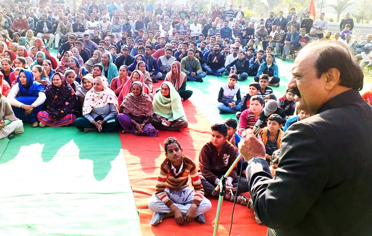 Senior NC leader, SS Slathia addressing public meeting in Ramgarh area of Samba on Monday.