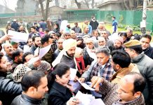 Advisor Khurshid Ahmad Ganai listening grievances of people in Srinagar on Sunday.
