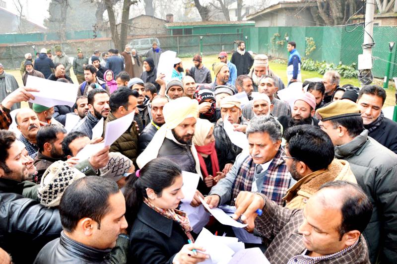 Advisor Khurshid Ahmad Ganai listening grievances of people in Srinagar on Sunday.