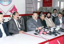 NC provincial president, Devender Singh Rana, flanked by senior party leaders at a press conference in Jammu on Saturday. —Excelsior/Rakesh