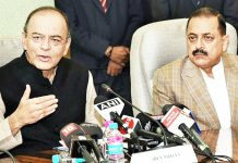 Union Finance Minister Arun Jaitley, flanked by Minister In-Charge Department of Pensions Dr Jitendra Singh, briefing the media at New Delhi on Monday.