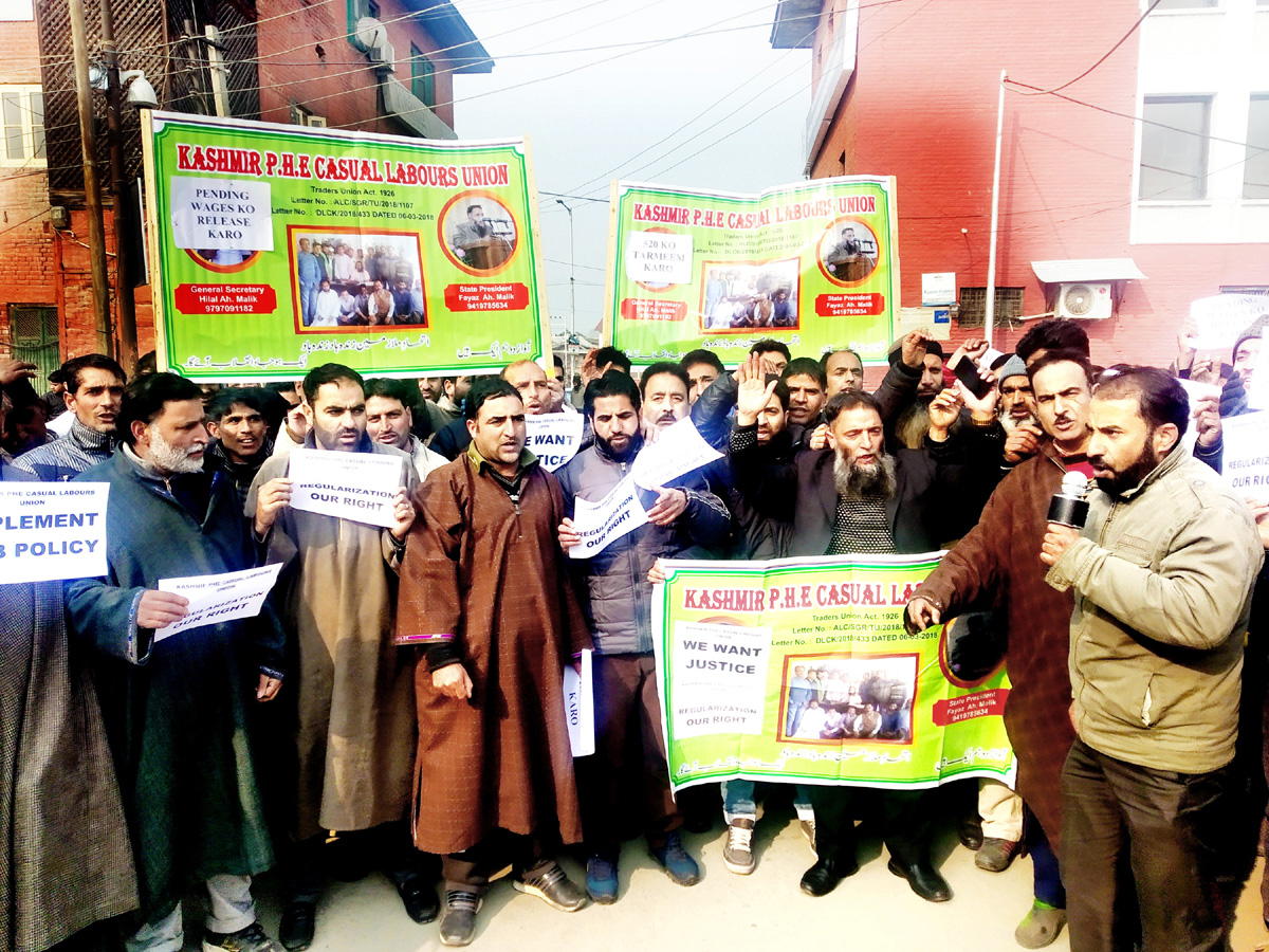 PHE employees protesting in Srinagar on Monday. -Excelsior/Shakeel