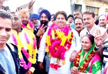 Senior Cong leader Raman Bhalla interacting with elected Sarpanches, Panches and party workers at a function in Jammu on Sunday.