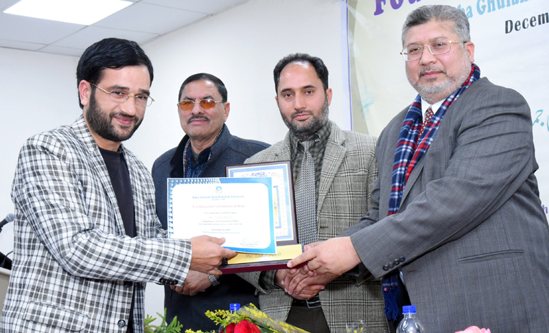 VC presenting Best Researcher award during Foundation Day function of BGSBU.