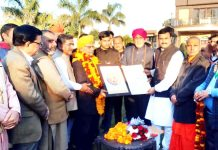 Former Minister, Sham Lal Sharma felicitating Sanskrit Scholar, Dr Chander Mouli Raina at a function in Jammu on Sunday.