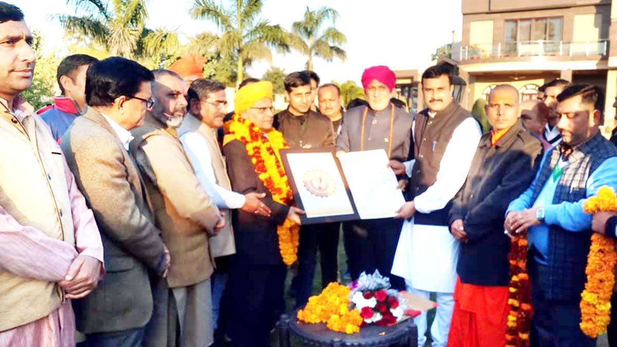 Former Minister, Sham Lal Sharma felicitating Sanskrit Scholar, Dr Chander Mouli Raina at a function in Jammu on Sunday.