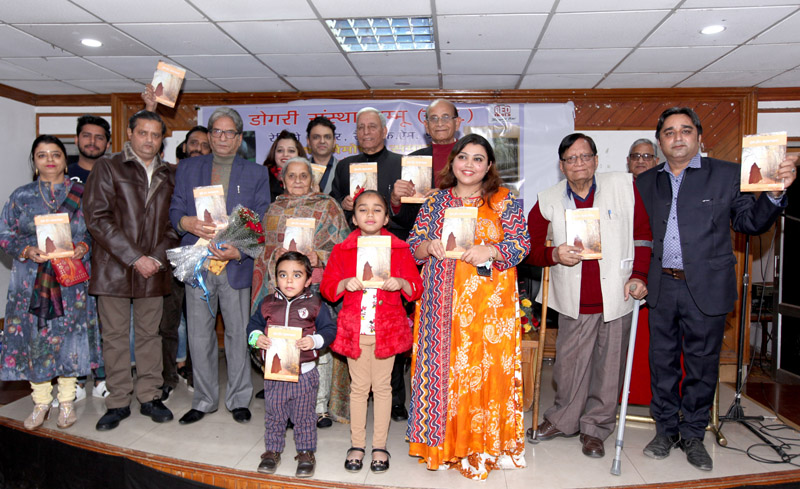Literary personalities and other guests during release of Chaman Arora's book of Dogri short stories at Jammu. —Excelsior/Rakesh