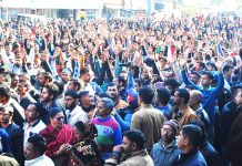 PHE daily wagers taking out large protest rally at B C Road in Jammu on Monday. -Excelsior/ Rakesh