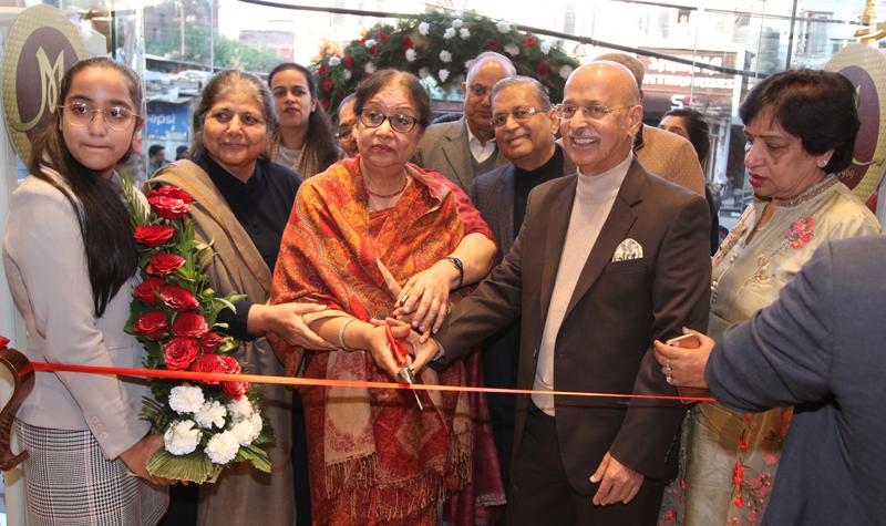 Chairman, Monalisa Group, Vinod Sachdeva along with his wife, Usha Sachdeva, inaugurating new store of the Group at Residency Road, Jammu.