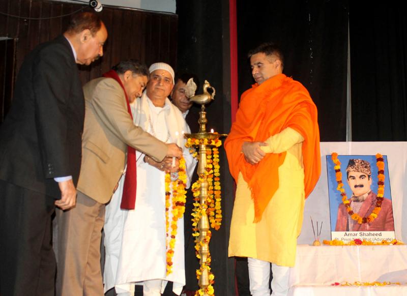 BJP President, Ravinder Raina and K P leaders lighting the lamp at Chetna Divas function at Jammu on Thursday. -Excelsior/Rakesh
