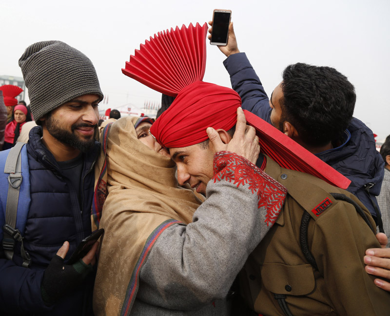 A pass out recruit being hugged by his mother. —Excelsior/Shakeel