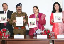 DGP Dilbag Singh and others releasing a booklet during a function at Jammu University on Monday.