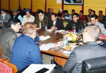 Advisor K A Ganai chairing a meeting on Friday.
