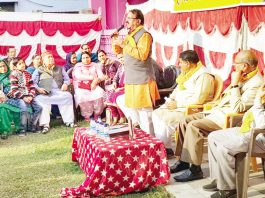Corporator Surinder Sharma expressing his views during a function at Shiv Shakti Mandir, Pamposh Colony Janipur, Jammu.
