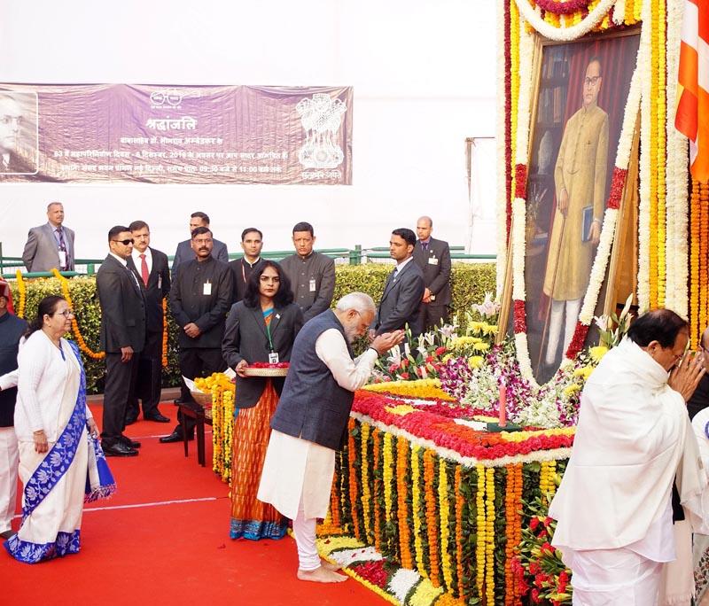 Prime Minister Narendra Modi paying homage to Babasaheb Dr. B R Ambedkar on his 63rd Parinirvan Divas, in New Delhi on Thursday. (UNI)