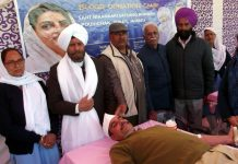 Volunteer donating blood during a camp by Sant Nirankari Foundation on Sunday.