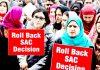 JK Bank employees protesting in Srinagar on Sunday. -Excelsior/Shakeel