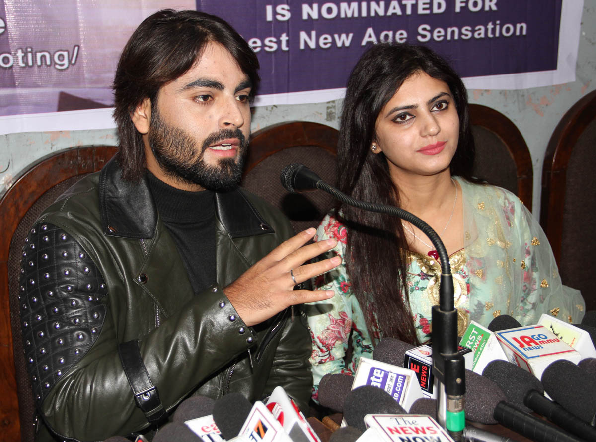 Meet Kour, a singer from J&K along with Raja Sarfaraz (writer and actor), addressing a press conference at Jammu. -Excelsior/Rakesh