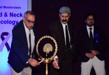 Chief guest lighting ceremonial lamp during inaugural of 3rd Masterclass on Head & Neck Oncology by SMVD Narayana Hospital.