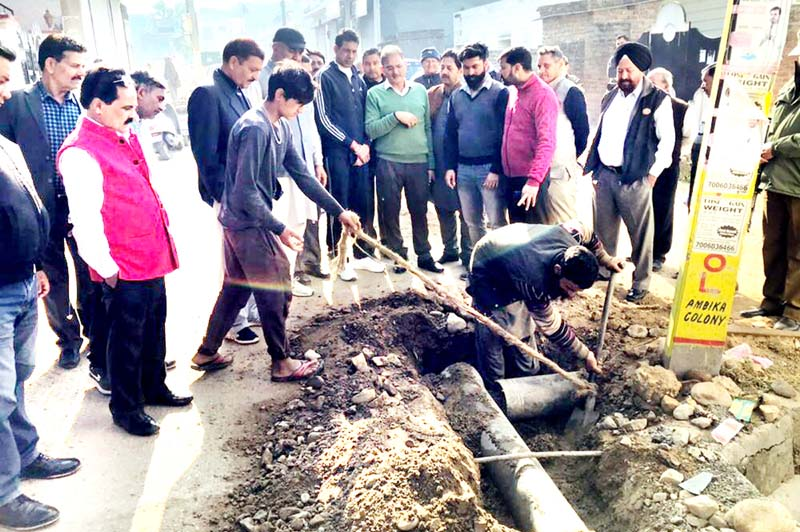 Former Deputy CM, Kavinder Gupta kick starting laying of water supply pipes at Jallo Chak in Gandhi Nagar Assembly Segment on Wednesday.