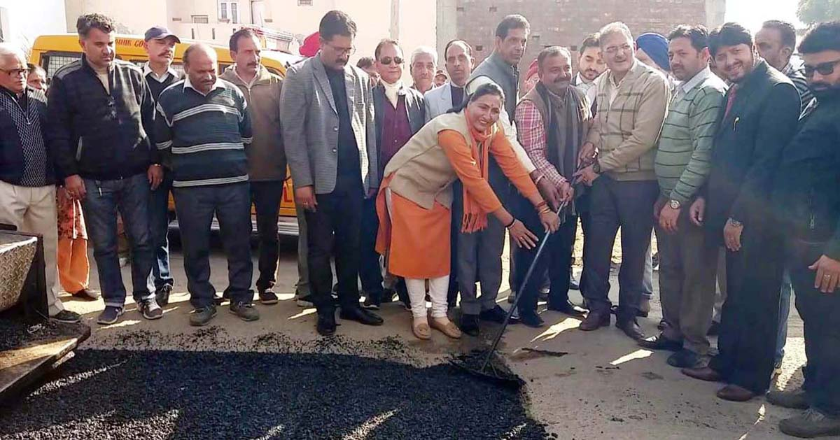 Former Deputy CM, Kavinder Gupta kick starting blacktopping of road in Sainik Colony on Tuesday.