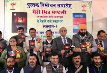 Members of Meri Mitra Mandali releasing books on Monday.
