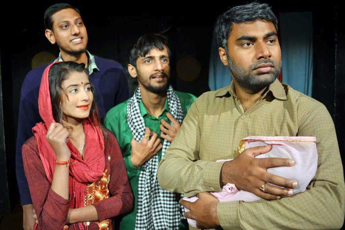 A scene from Hindi play 'Balak' staged at Jammu on Friday.