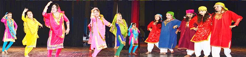 Artists performing during a cultural programme organised by Radio Sharda at Jammu on Thursday.