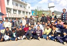 NPP activists and others staging protest outside DC office at Udhampur on Tuesday.