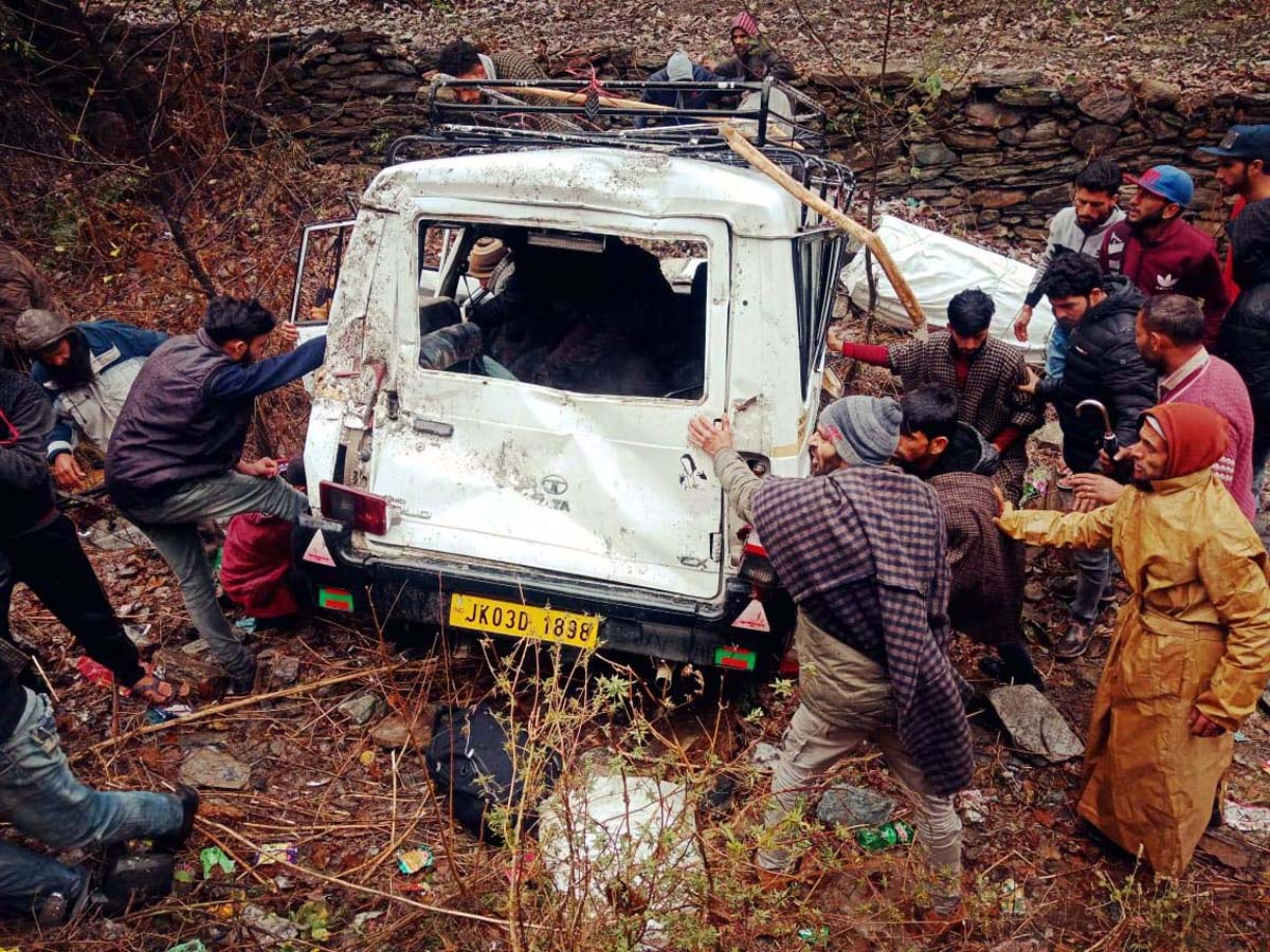 Locals rescuing injured persons from ill-fated vehicle in Ramban. -Excelsior/Parvaiz