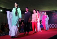 Models walking ramp to display the beauty of silk under the banner of Silk Era.