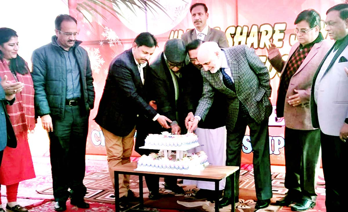 Dignitaries cutting the Christmas cake during all communities get-together at Jammu on Friday.