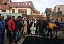 Former Deputy CM, Kavinder Gupta kick starting black topping of lanes at Chinar Mohalla, Channi Rama on Wednesday.