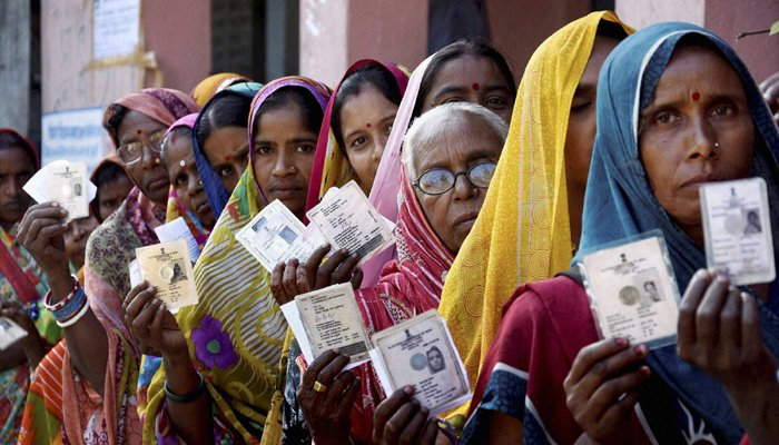 Image result for Brisk polling in UP amid EVM glitches