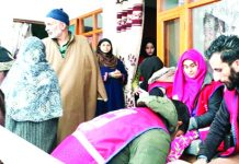 People attending dental check up camp organised at Srinagar on Saturday.