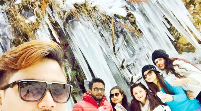 Tourists enjoy freezed snow at Nalthi in Bhaderwah. -Excelsior/Tilak Raj