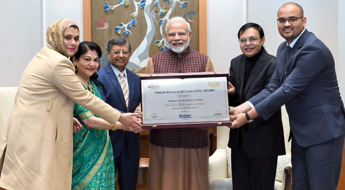 Prime Minister Narendra Modi receiving the first-ever Philip Kotler Presidential award from Professor, EMORY University, Georgia, USA Dr Jagdish N Seth in New Delhi on Saturday. (UNI)