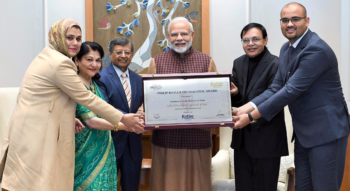 Prime Minister Narendra Modi receiving the first-ever Philip Kotler Presidential award from Professor, EMORY University, Georgia, USA Dr Jagdish N Seth in New Delhi on Saturday. (UNI)
