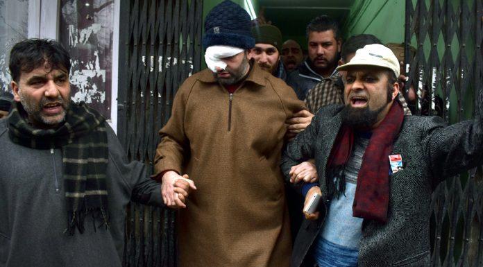 Injured Deputy Mayor of SMC, Sheikh Imran being taken to hospital in Srinagar on Monday. -Excelsior/Shakeel